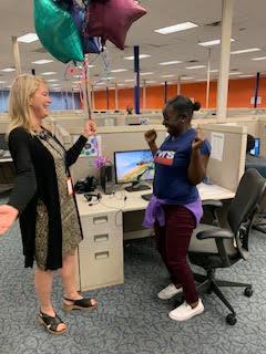 Heather D. Blease presents balloons to SaviScholar Jequetta Dean