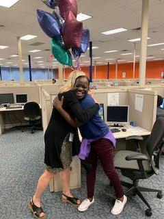 Heather D. Blease shares a hug with Jequetta Dean, the first SaviScholar